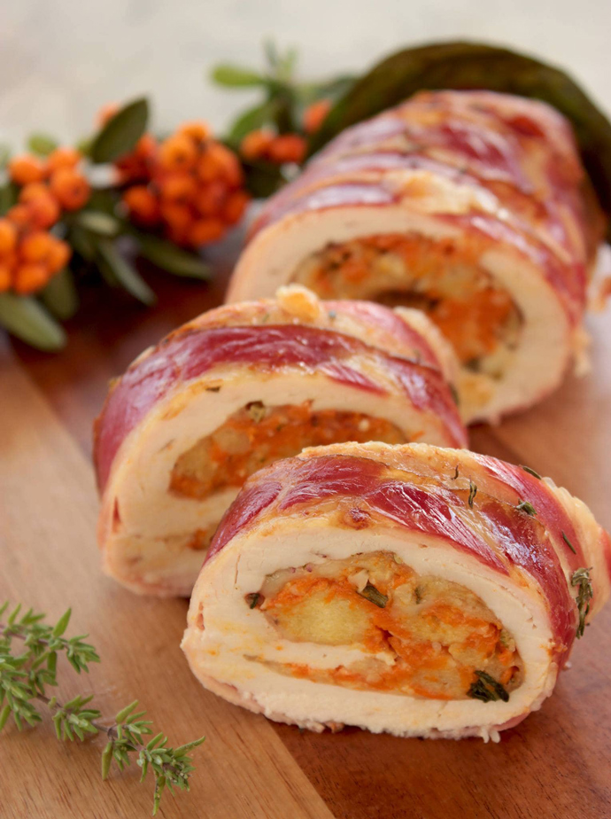 Turkey rouladewith Pumpkin & Cranberry stuffing sliced on a chopping board