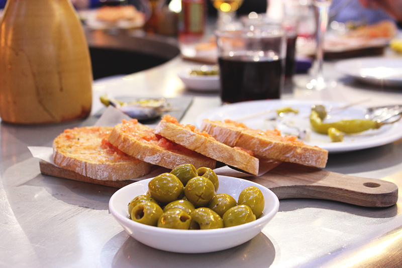 Sangria served with Andalusian style olives and Pan con Tomate, roasted bread rubbed with tomatoes and olive oil.