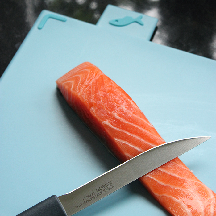 Joseph Joseph light blue chopping board for raw fish.