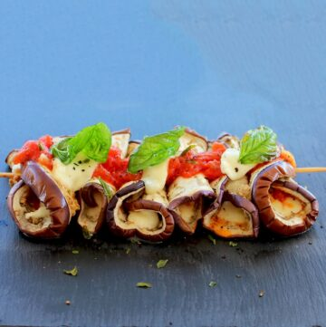 Eggplant Parmigiana Skewers topped with mozzarella and cubed tomato.