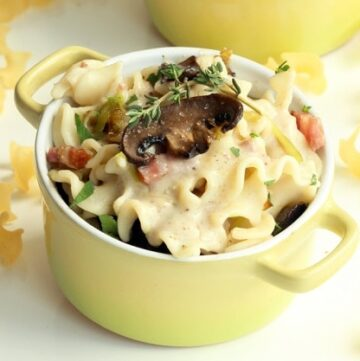 gluten-free pasta bake topped with mushrooms and pancetta and served in individual pot