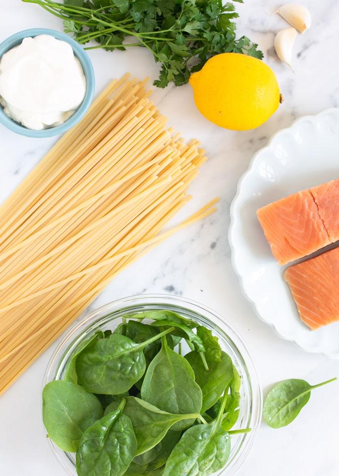 recipe ingredients: linguine pasta, salmon fillets, spinach leaves, lemon, garlic, creme fraiche, parsley.