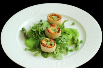 Can you believe these are actually vegan? A simple ingredient can make an incredible main course! https://www.thepetitecook.com/vegan-scallops-with-spring-greens/