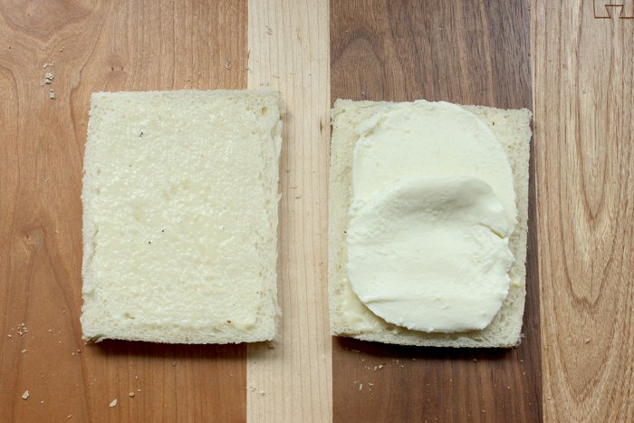 recipe step two: one slice of white bread brushed with bechamel sauce, one slice topped with mozzarella slices