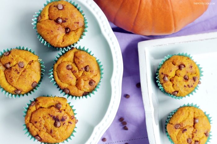 dairy-free pumpkin muffins on a cake stand and on a serving tray