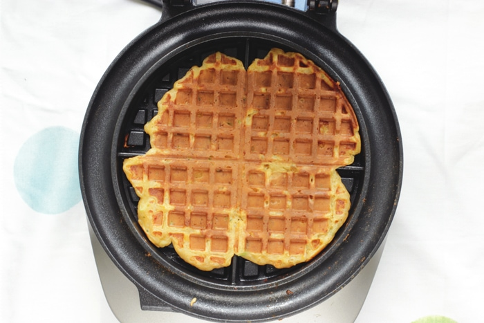 waffle batter cooked through onto the waffle maker