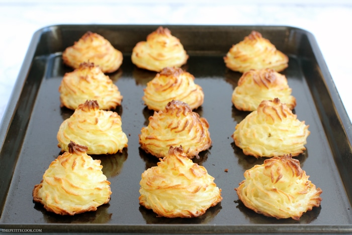 recipe step 3: cooked duchess potatoes on baking tray, ready to serve