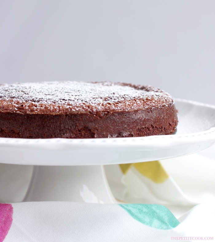 2-Ingredient nutella cake on a white cake stand,