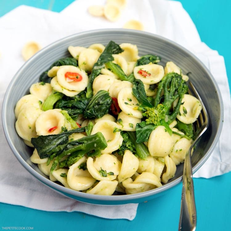 orecchiette with sprouting broccoli and choy sum in a bowl with a fork