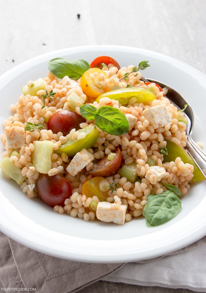 A fresh, vibrant vegetarian salad with summer Mediterranean flavors - This Barley Greek Salad is quick to make, great on its own and simply amazing with any grilled fish or meat! Recipe from thepetitecook.com