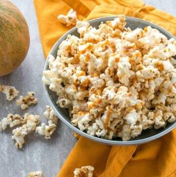 Salty, sweet, lightly spiced and crunchy, this super quick Caramel Pumpkin Spice Popcorn is sure to become your new favorite movie buddy! Recipe from thepetitecook.com