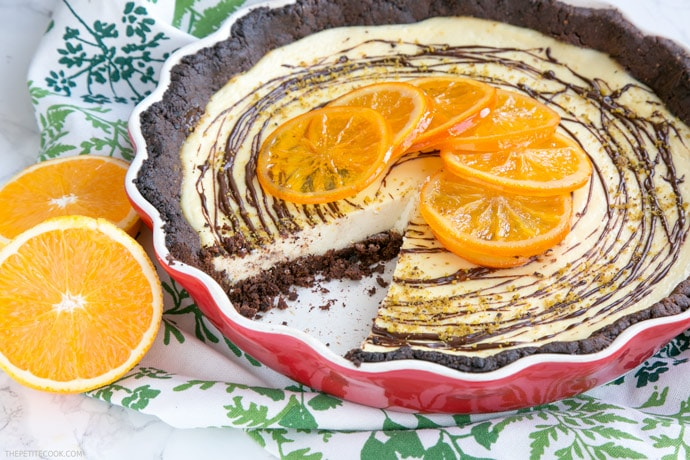 A crispy chocolatey gluten-free crust paired beautifully with a sweet and tangy ricotta and orange filling - This Orange Chocolate tart is a the perfect dessert for a fall afternoon treat.