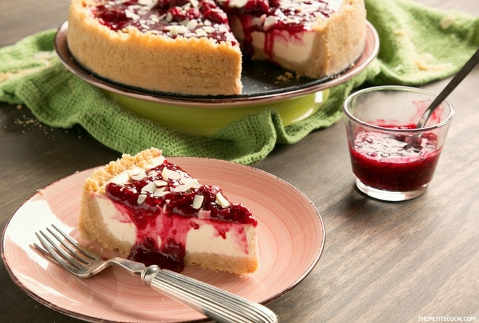 Sweet and tangy flavors combine beautifully to make one of the most iconic desserts ever - This New York style Raspberry Cheesecake is pure heaven in a bite! Recipe from thepetitecook.com