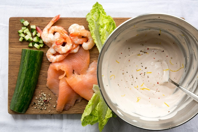 A healthy take on a British classic, this quick gluten-free no-mayo Salmon and Prawn Cocktail is the perfect starter for all the seafood lovers out there! Recipe from The Petite Cook - www.thepetitecook.com