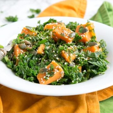 Healthy and fulfilling, this Spicy Sweet Potato and Kale Salad is packed with nutrients, dairy-free, gluten-free and vegan - The perfect warm salad to enjoy on a chilled day. Recipe from The Petite Cook - thepetitecook.com