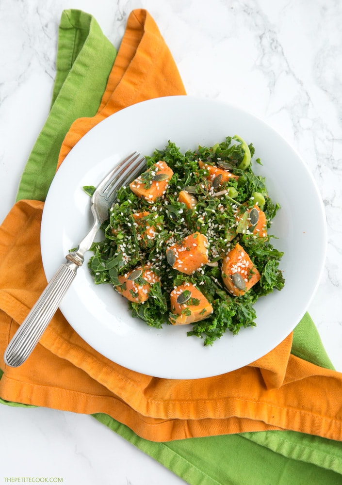sweet potato and kale salad on a white plate
