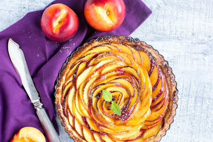 A gorgeous Nectarine Tart made with a magic dairy-free olive oil crust - A delicious simple summer treat that's super easy to make. Recipe by The Petite Cook