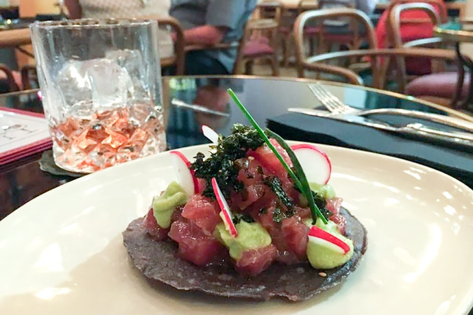 tuna tartare tostada on plate