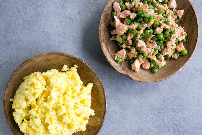 saffron rice on a plate and salmon and pea stir-fry on another plate