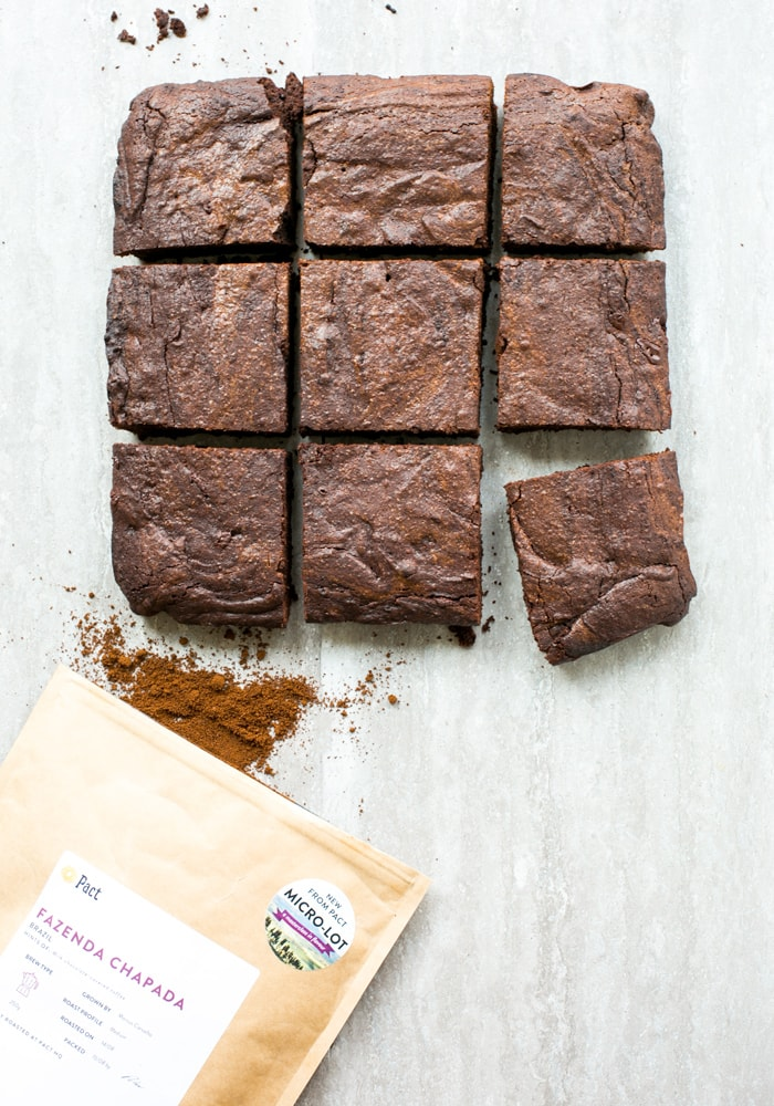 espresso brownies cut into squares , pact coffee pack on the left down side of the picture