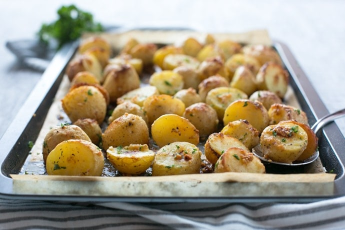 Truffle Pesto Roasted Potatoes make a fantastic side to serve on special occasions such as Thanksgiving, Christmas and New Year's Eve. They're also simple and quick enough to whip up for a weeknight dinner! Recipe by The Petite Cook