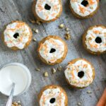 These Carrot Cake Baked Donuts are the perfect easy-to-make Easter treat that everyone will love - Packed with veggies, these are totally guilt-free, naturally dairy-free and low fat! Recipe by The Petite Cook