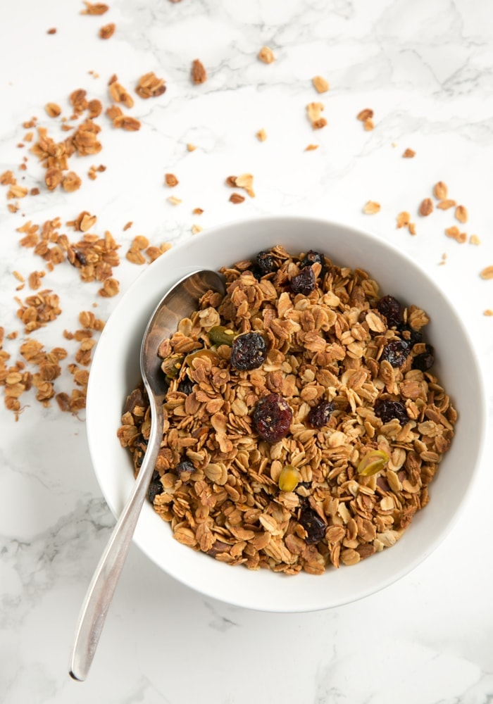 a bowl of homemade granola with a spoon