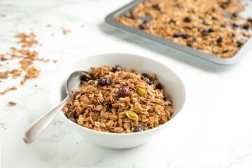 This Christmas Homemade Granola recipe is loaded up with the delicious flavors of the holiday season. Naturally vegan and gluten-free, it would also make a pretty homemade gift for someone you love.