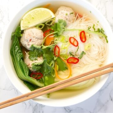 Thai Turkey Meatball Soup in a bowl with chopsticks on the side