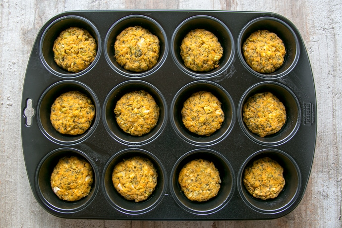 veggie sweet potato fritters in a muffin tin