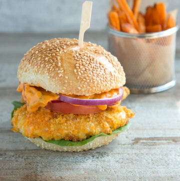 buttermilk oven fried burger with spicy mayo, served with sweet potato fries