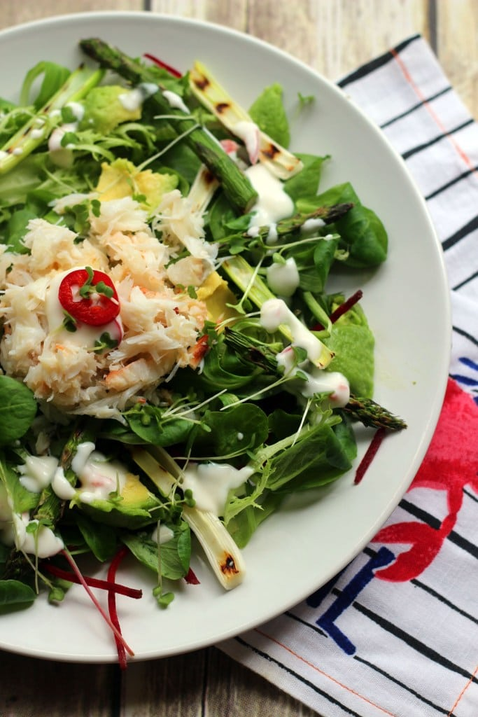 crab, avocado and greens salad in a bowl