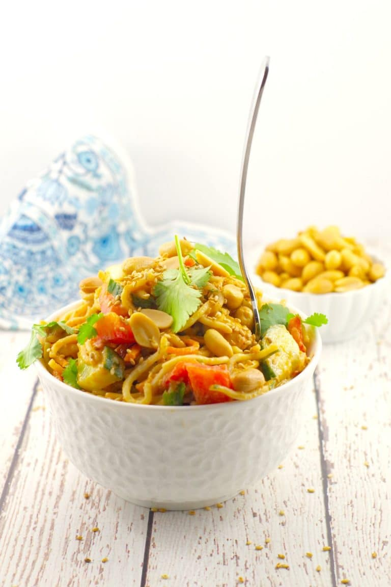vegan peanut noodles salad in a bowl with chopsticks
