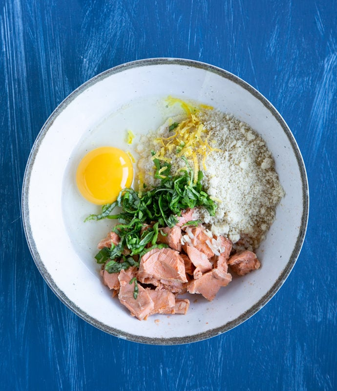 salmon, lemon zest, egg, chopped basil leaves and almond flour in a white bowl