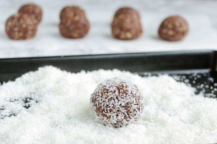 recipe step 4: chocolate balls rolled into coconut flakes.