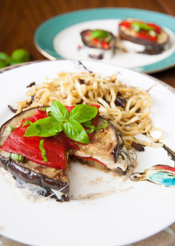 grilled eggplant stack stuffed with mozzarella and topped with bell pepper.