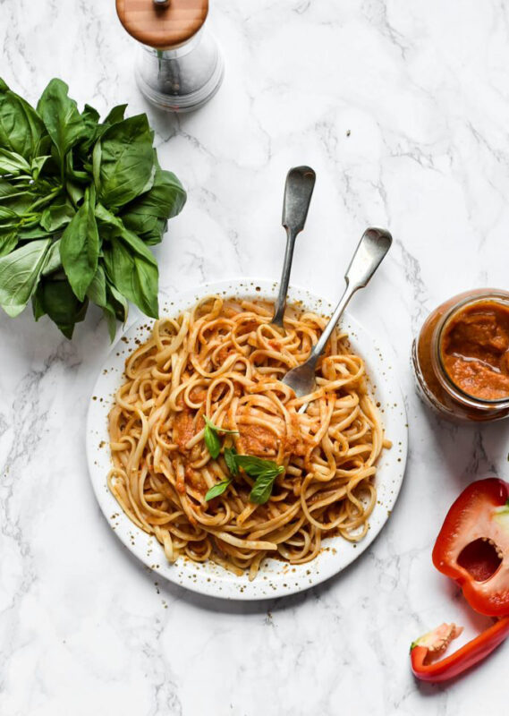 hidden vegetable sauce with spaghetti on a plate with serving forks.