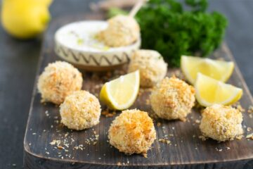 baked fish croquettes served with garlicky yogurt dip and lemon wedges