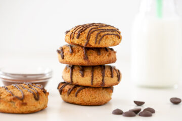 2-ingredient cookies wioth a glass of milk on the side