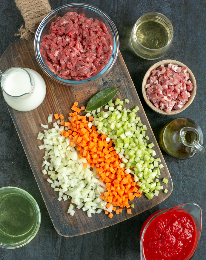 traditional bolognese sauce ingredients: minced beef, pancetta, white wine, extra-virgin olive oil, tomato sauce, vegetable broth, milk, carrot celery and onion mirepoix