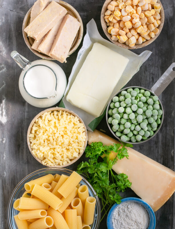 ingredients for the recipe: tuna chunks, sweetcorn, peas, butter, parmesan cheese, milk, strong cheddar, rigatoni pasta, flour.