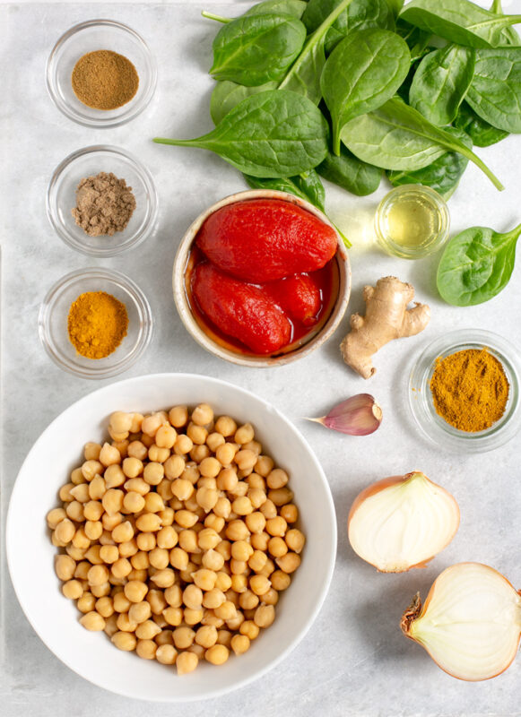 recipe ingredients: chickpeas, tomatoes, spinach, spices, onion, garlic, ginger, vegetable oil