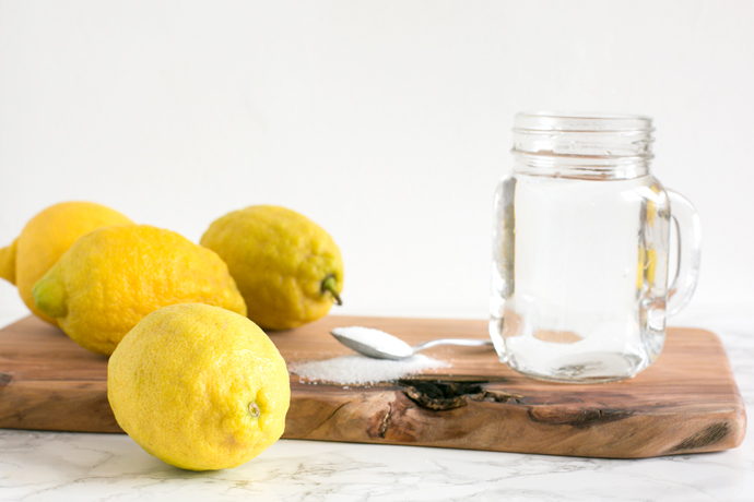 4 lemons, 1 teaspoon of sugar and a jug full of water.