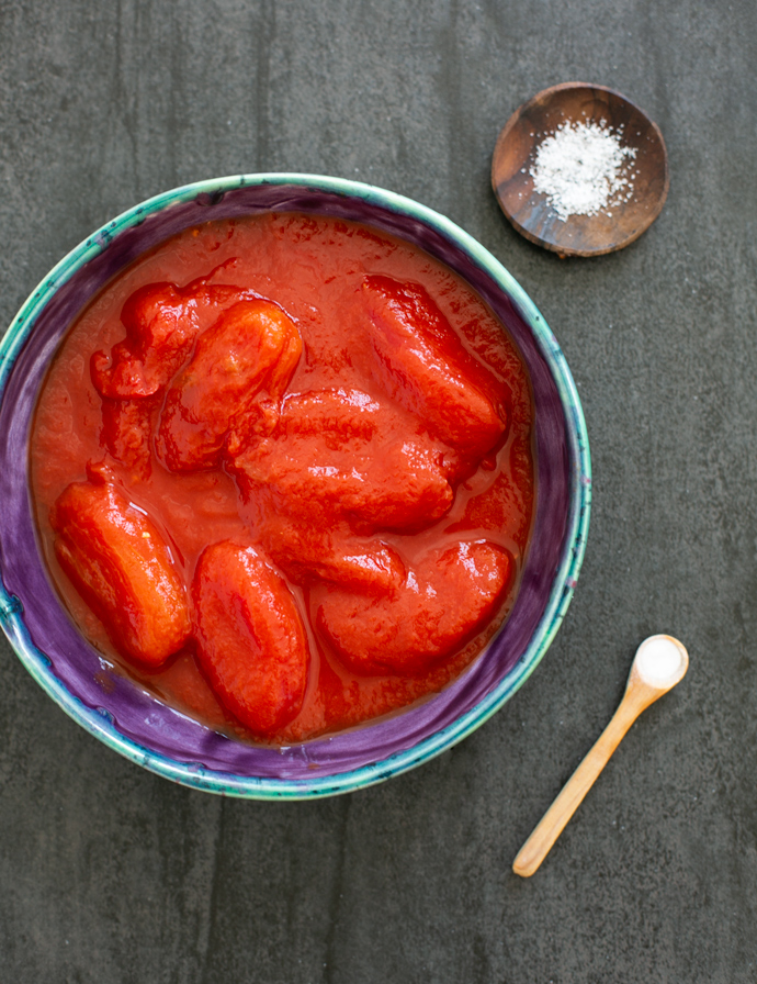 san marzano canned tomatoes in a plate, teaspoon of baking soda, sea salt on a small plate