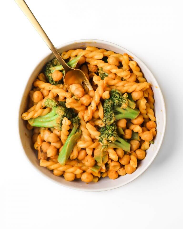 creamy chickpea pasta sauce with pasta and broccoli.