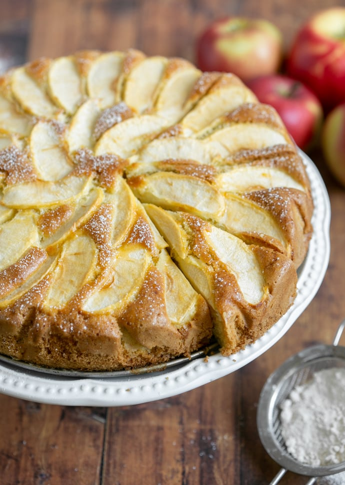 torta di mele (apple cake) topped with sliced apples and confectioner's sugar.