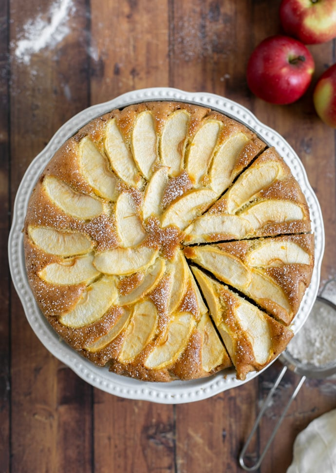 torta di mele, aka apple cake with sliced apples on top and dusted with confectioner's sugar.