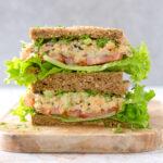 no tuna chickpea salad sandwich on a chopping board.