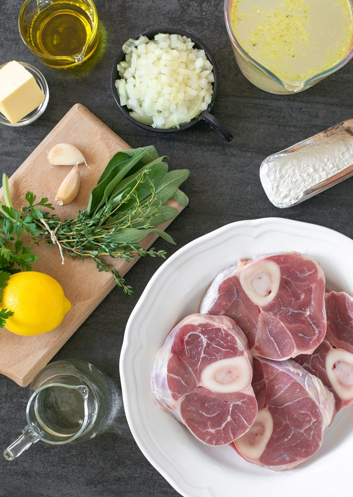 ossobuco recipe ingredients: veal shanks, broth, flour, onion, oil, garlic, butter, lemon,thyme, sage, parsley, white wine.